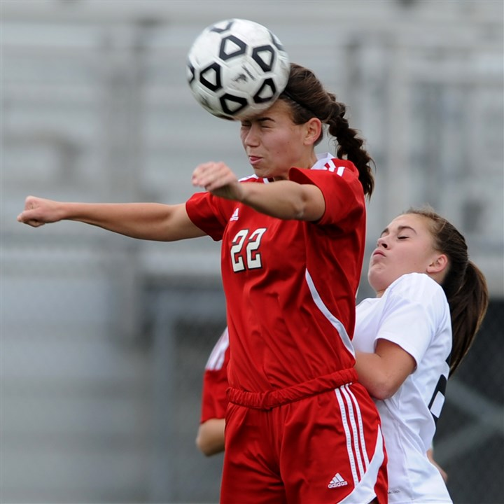 1109mhSenecaVPetersZoneSpor.6.jpg Madison Santo of Peters Township's hits a header against Seneca Valley during the PIAA quarterfinal match Saturday at Chartiers Valley High School stadium. Seneca Valley won, 2-0.