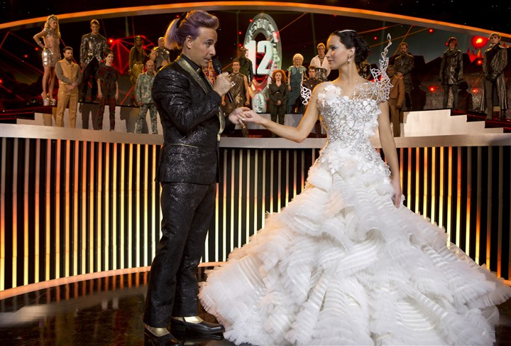 "TheHungerGames2 Caesar Flickerman (Stanley Tucci) and Katniss Everdeen (Jennifer Lawrence) in ""The Hunger Games: Catching Fire."""