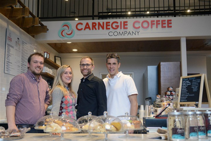 coffeeMag01-36 At the Carnegie Coffee Co. are, from left, manager Matthew Harkness, business owners Ashley Comer and Greg Romeo, and building owner Craig Cozza. The coffee shop is inside Carnegie's old post office, as is the Medicine Shoppe.