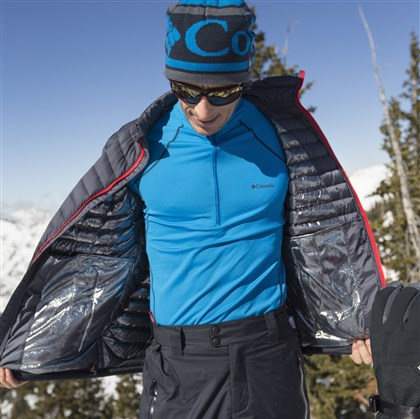 Powerfly down jacket by Columbia Powerfly down jacket, $220, and men's heavyweight 1⁄2 zip baselayer, $70, by Columbia.