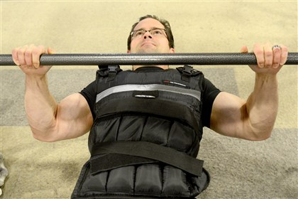 20131112ppHxweightvests2HEALTH-1 Victor Prisk, an orthopedic surgeon, uses a weighted vest during resistance exercising such as push-ups and pull-ups to build strength.