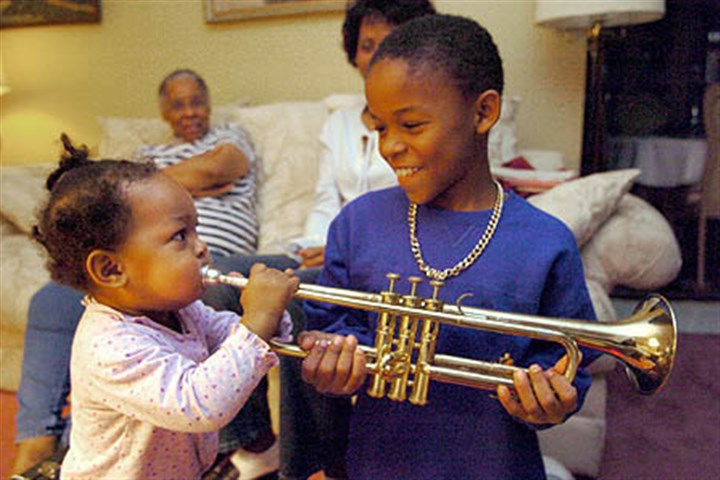 20041228acwumphrey4_450.jpg Aaliyah Umphrey tries to play brother Andrew Umphrey's trumpet at their grandmother's home in Chartiers City. Their mother, Andrea, was the victim of one of the state's 127 domestic violence homicides this year.
