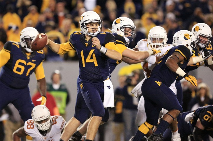 millard1115-5 West Virginia quarterback Paul Millard throws to a receiver during the second quarter of a game against Texas in Morgantown earlier this month.