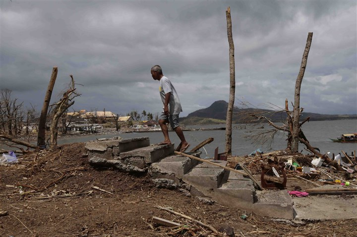 A survivor, Tacloban city, Leyte province, Philippines A survivor walks through the debris near the shoreline at Tacloban city, Leyte province, in central Philippines. Typhoon Haiyan, one of the most powerful storms on record, struck the Philippines on Nov. 8.