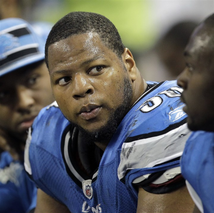 suh-8 Detroit Lions defensive tackle Ndamukong Suh (middle) has a nasty on-field reputation and will be plenty for the Steelers offensive line to handle on Sunday.
