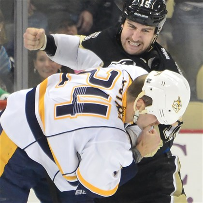 Tanner Glass connects Tanner Glass connects with a right fist to the head of the Predators' Eric Nystrom Friday at Consol Energy Center. The Penguins won, 4-1.