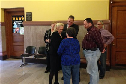 20131115minchverdict Allegheny County assistant district attorney Lisa Pellegrini hugs Mary Michael, the mother of Melissa Groot, on Friday. Ms. Michael's former son-in-law, John Minch, was found guilty of first-degree murder in Groot's 1999 death.