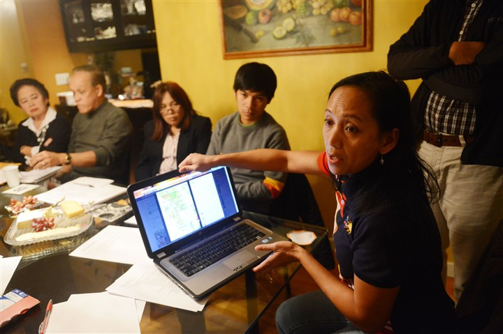 20131114MWHmeetingLocal02-1 Rebecca Quemado of O'Hara talks during a gathering of regional Filipino immigrants to discuss disaster aid.