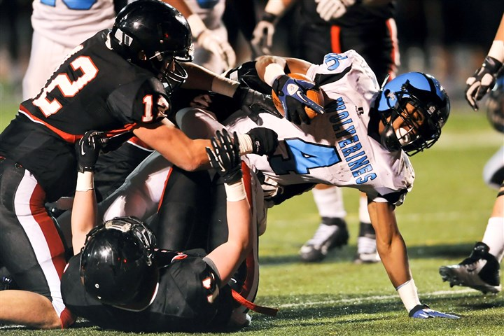 Woodland Hills' Miles Sanders Woodland Hills' Miles Sanders pushes for extra yardage Friday night against Upper St. Clair at Baldwin.