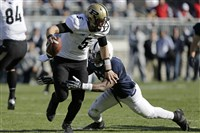 Purdue quarterback Danny Etling is sacked by Penn State safety Adrian Amos for a 12-yard loss on Nov. 16, 2013.