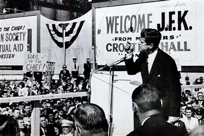 Kennedy in Monessen President John F. Kennedy speaks to an estimated 25,000 in Monessen on Oct. 13, 1962. The photo, by Noel P. Clark, ran in the Oct. 26, 1962, issue of Life Magazine. Albert J. Fuoco, father of Pittsburgh Post-Gazette staff writer Michael A. Fuoco, is pictured in the bottom right section of the photo, wearing a white coat.