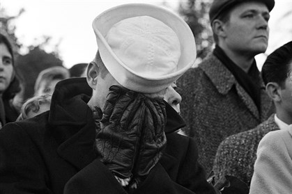 JFK mourners Nov. 25, 1963: A sailor weeps as the caisson bearing the body of President John F. Kennedy travels past him and other mourners at Arlington National Cemetery, where Kennedy was buried.
