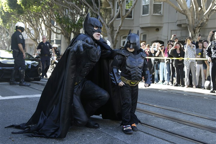 Boys Batman Wish Miles Scott, dressed as Batkid, right, walks with Batman before saving a damsel in distress in San Francisco on Friday