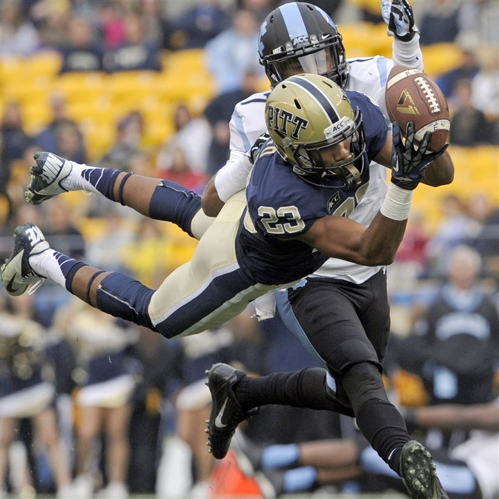 20131116mfpittsports01.jpg Pitt's Tyler Boyd pulls in a pass against North Carolina's Tim Scott in the first quarter at Heinz Field Saturday afternoon.