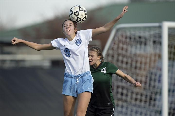 central valley girls soccer Central Valley's Katie Alexander heads the ball away from Trinity's Miranda Rogliano.