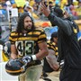 """He is a legendary Steeler and a legendary man,"" Steelers coach Mike Tomlin, right, said of Troy Polamalu."