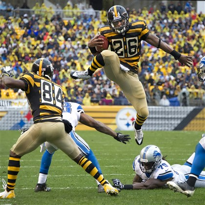 20131117pdSteelersSports01.jpg The Steelers' Le'Veon Bell leaps over top of the Lions' Willie Young in the second quarter for a first down in a game earlier this month at Heinz Field.