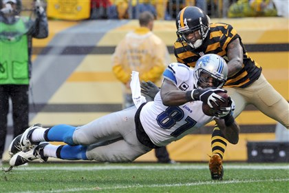 Megatron trumps swag Detroit's Calvin Johnson, shown here pulling in a pass for a touchdown in front of Ike Taylor, has become the standard-bearer for tall receivers in the NFL; the Steelers might like to add a component like him in the 2014 draft.