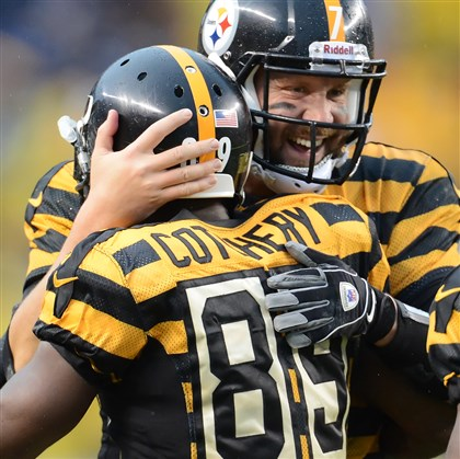 cook1118 Steelers quarterback Ben Roethlisberger hugs receiver Jerricho Cotchery after finding him for a touchdown in the fourth quarter.