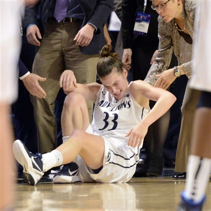 wbbpsu2 Penn State's Maggie Lucas is helped to her feet in the second half of an NCAA college basketball game against Connecticut.