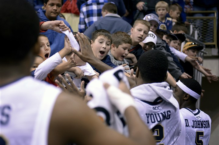 20131117jrPittSports7-6 Young boys gather for high-fives and used towels as the Pitt men's basketball team leaves the court after their 84-52 win over Howard Sunday at the Petersen Events Center in Oakland.