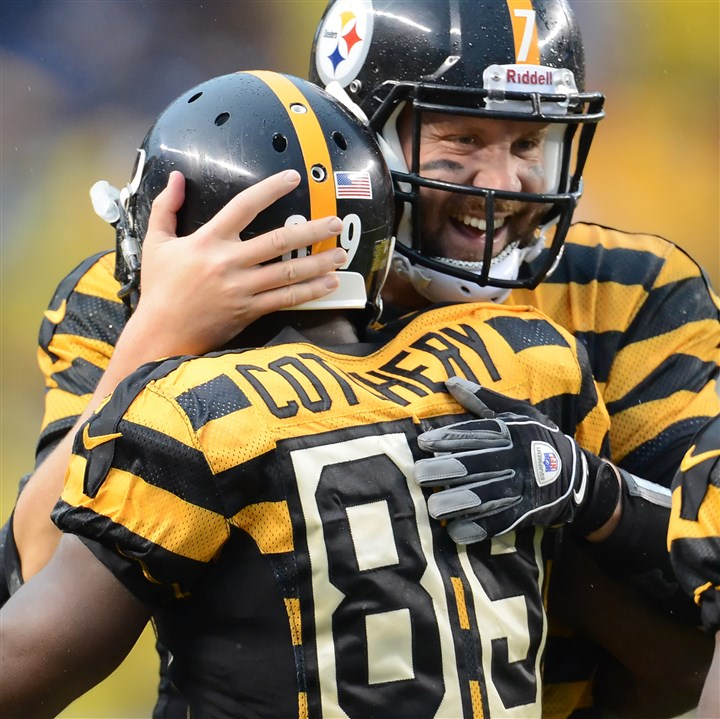 20131117pdSteelersSports13-2 Quarterback Ben Roethlisberger hugs Jerrichio Cotchery after a touchdown Sunday in the fourth quarter against the Lions at Heinz Field.