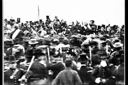 A Nov. 19, 1863, photo by Alexander Gardner shows President Abraham Lincoln, slightly left of center with no hat, in Gettysburg at the dedication of a portion of the battlefield as a national cemetery.