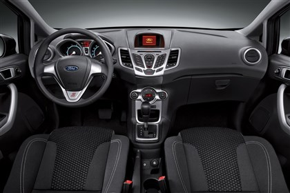 20131118FordfiestaintBIZ-1 Interior: Even the inexpensive trim level seats were comfortable in the 2014 Ford Fiesta. A Sync-less radio complements the simple heater controls quite nicely.