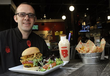 burgatorymag04-8 Brad Kohut , executive chef of Burgatory, at the Waterworks location with the full experience: a burger, salad, shake and fries.