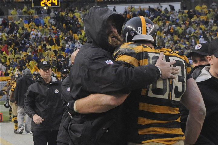 20131117lrsteelerslions28-1 Heath Miller, right, gets a hug from Brett Keisel as he comes off the field late in the fourth quarter of the Steelers win over the Detroit Lions at Heinz Field.