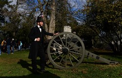 Lincoln re-enactor Rick Miller of Cranberry poses for photographs Tuesday, after a ceremony marking the 150th anniversary of President Abraham Lincoln's Gettysburg Address in the Soldiers' National Cemetery in Gettysburg