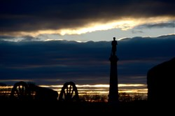 The sun rises over Evergreen Cemetery before the start of a ceremony marking the 150th anniversary of President Abraham Lincoln's Gettysburg Address across the street in the Soldiers' National Cemetery in Gettysburg.