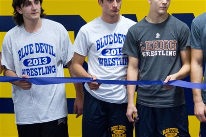 20131119holebowrestlingsouth Members of the Mt. Lebanon High School wrestling team cut the ribbon Monday for the school's new wrestling room.