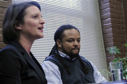 20131119lrhendersonlocal06-5 Dennis Henderson listens to ACLU attorney Sara Rose, left, Tuesday as she announces the filing of a lawsuit against Pittsburgh police Officer Jonathan Gromek, accused of violating Mr. Henderson's civil rights during an arrest in Homewood in June.