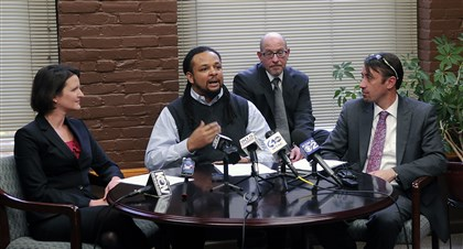 20131119lrhendersonlocal08-7 Dennis Henderson, 2nd left, flanked by attorneys Sara Rose of the ACLU, left, Glen Downey, right, of Healey & Hornak, and James Love, 2nd right, also from Healey & Hornak, talks about his arrest in June 2013 by Pittsburgh Police Officer Johnathan Gromek at a November 19, 2013 press conference announcing the filing of a lawsuit against Officer Gromek.