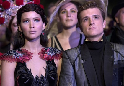 "TheHungerGames4-2 Jennifer Lawrence as Katniss Everdeen, left, and Josh Hutcherson as Peeta Mellark in ""The Hunger Games: Catching Fire."" The film releases Friday."