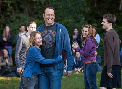 "DeliveryMan6 Britt Robertson (center, left) stars as Kristen, opposite Vince Vaughn who portrays David Wozniak in ""Delivery Man."""