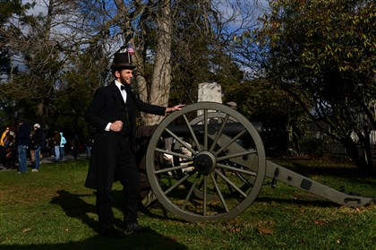20131119mwhGettysburgLocal1.1-9 Lincoln re-enactor Rick Miller of Cranberry poses for photographs before the start of a remembrance ceremony marking the 150th anniversary of Abraham Lincoln's Gettysburg Address in Soldiers' National Cemetery in Gettysburg.