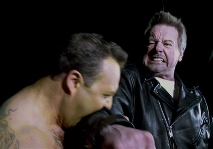 "WrestlingMAG  Marcus Staley attacks ""Rowdy"" Roddy Piper in the movie ""Pro Wrestlers vs. Zombies."""