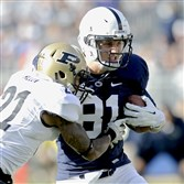 Purdue's Ricardo Allen, left, tries to stop Penn State's Adam Breneman as he runs down the field with the ball during an NCAA college football game Saturday, Nov. 16, 2013, in State College, Pa.