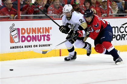 pens1121a Penguins defenseman Matt Niskanen and Capitals centerman Mikhail Grabovski go after the puck.