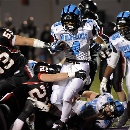 20131115woodlandsports06.jpg Woodland Hills' Miles Sanders gets into the end zone for a touchdown against Upper St. Clair.