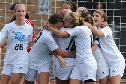 1109mhSenecaVPetersZoneSpor.8.jpg The Seneca Valley girls soccer team celebrate after scoring a goal against Peters Township in a PIAAA quarterfinal match on Nov. 9.