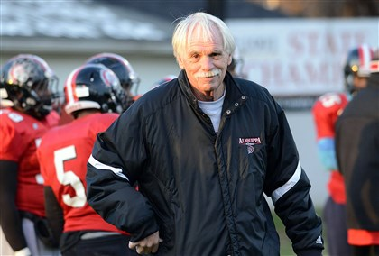 20131120radZmijanacSports10-7 Aliquippa High School football coach Mike Zmijanac runs the team's practice on Wednesday. The Quips will play for the WPIAL Class AA championship on Saturday.