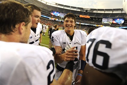 hack1121-1 Penn State's Christian Hackenberg celebrates with teammates after a game against Syracuse in August in East Rutherford, N.J. Penn State won 23-17.