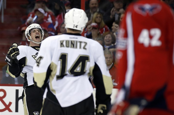 pens1121d-2 Sidney Crosby celebrates his goal with left wing Chris Kunitz in the second period against the Washington Capitals.