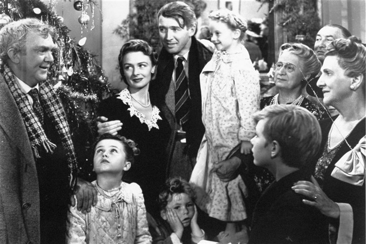 "It's a Wonderful Life-moviestillA In this 1946 file photo originally provided by RKO Pictures Inc., legendary actor James Stewart as George Bailey, center, is reunited with his wife played by actress Donna Reed, third from left, and family during the last scene of Frank Capra's ""It's A Wonderful Life."""