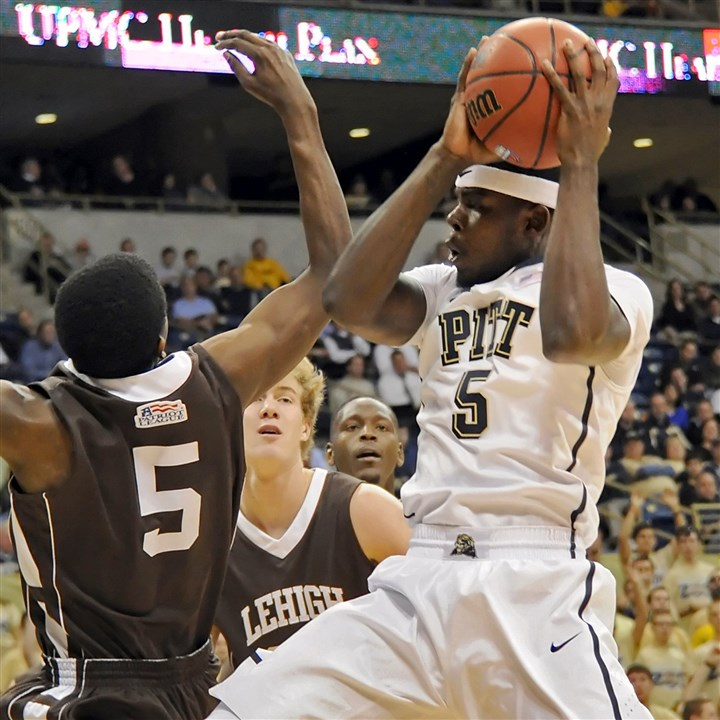 pittbb1124 Pitt's Durand Johnson pulls down a rebound against Lehigh's Austin Price in the first half at the Petersen Events Center Wednesday night.