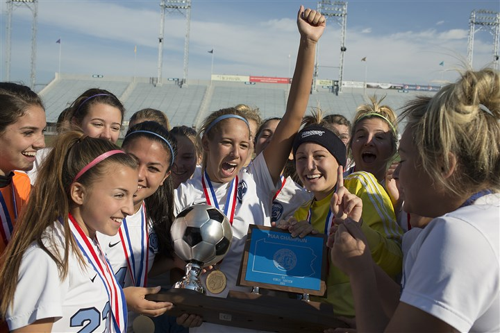 soccer_1116_jcw Central Valley girls soccer team celebrates its PIAA championship around the trophy at Hersheypark Stadium.