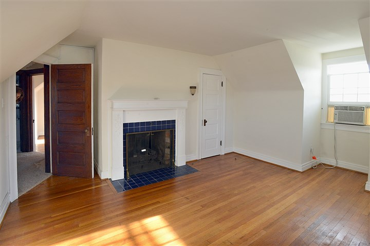 20131120radCenterHomeSunMag.9-7 The master bedroom features a functioning gas fireplace along with hardwood floors.